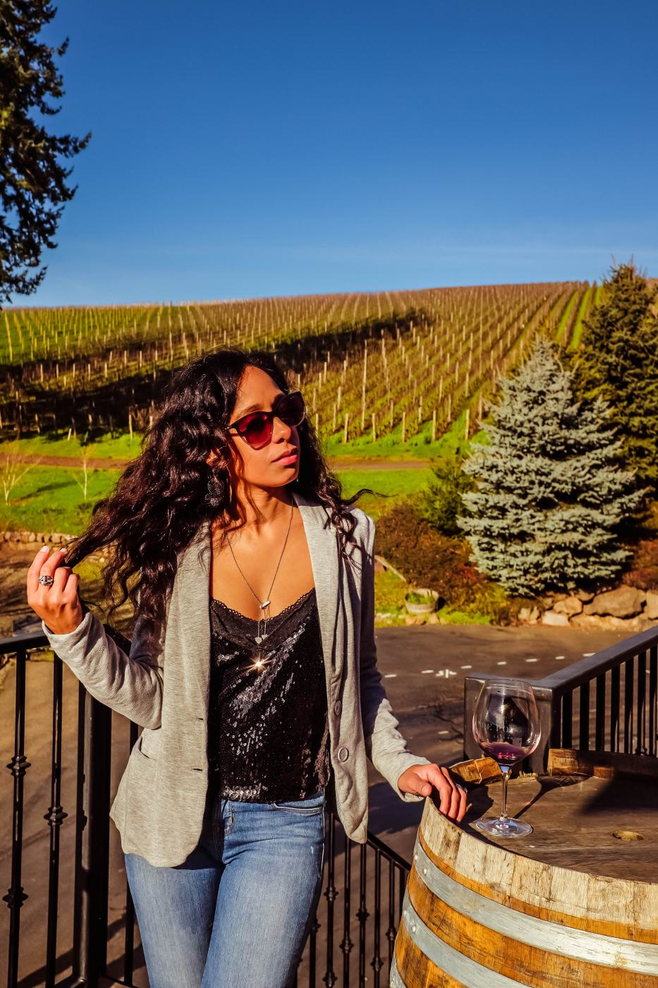 wineries willamette valley. Image enjoying a glass of Pinot Noir at De Ponte Cellars