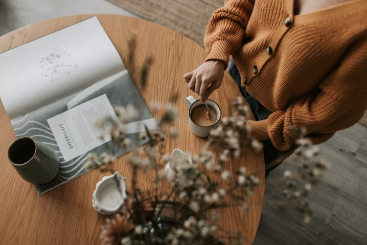 Photo showing a woman enjoying a healthy morning routine