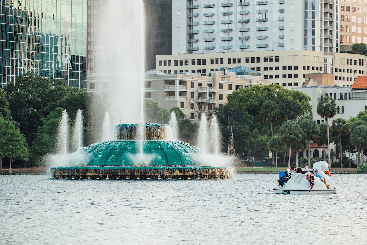 Things to do in Orlando for Adults-Swan boat by fountain at Lake Eola