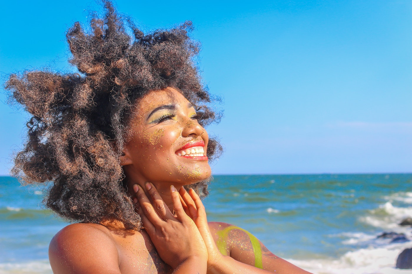 A happy women smiling and living with intention.