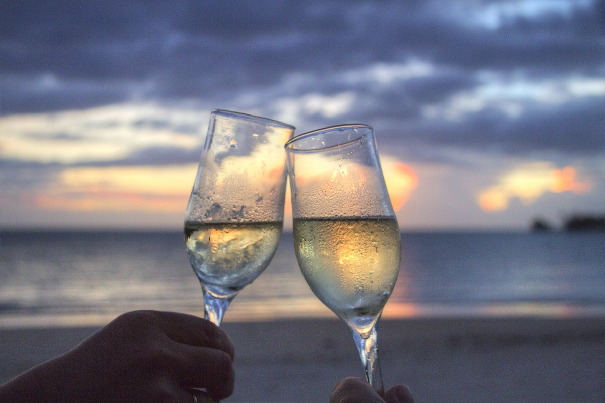Enjoying a sunset on the beach with wine