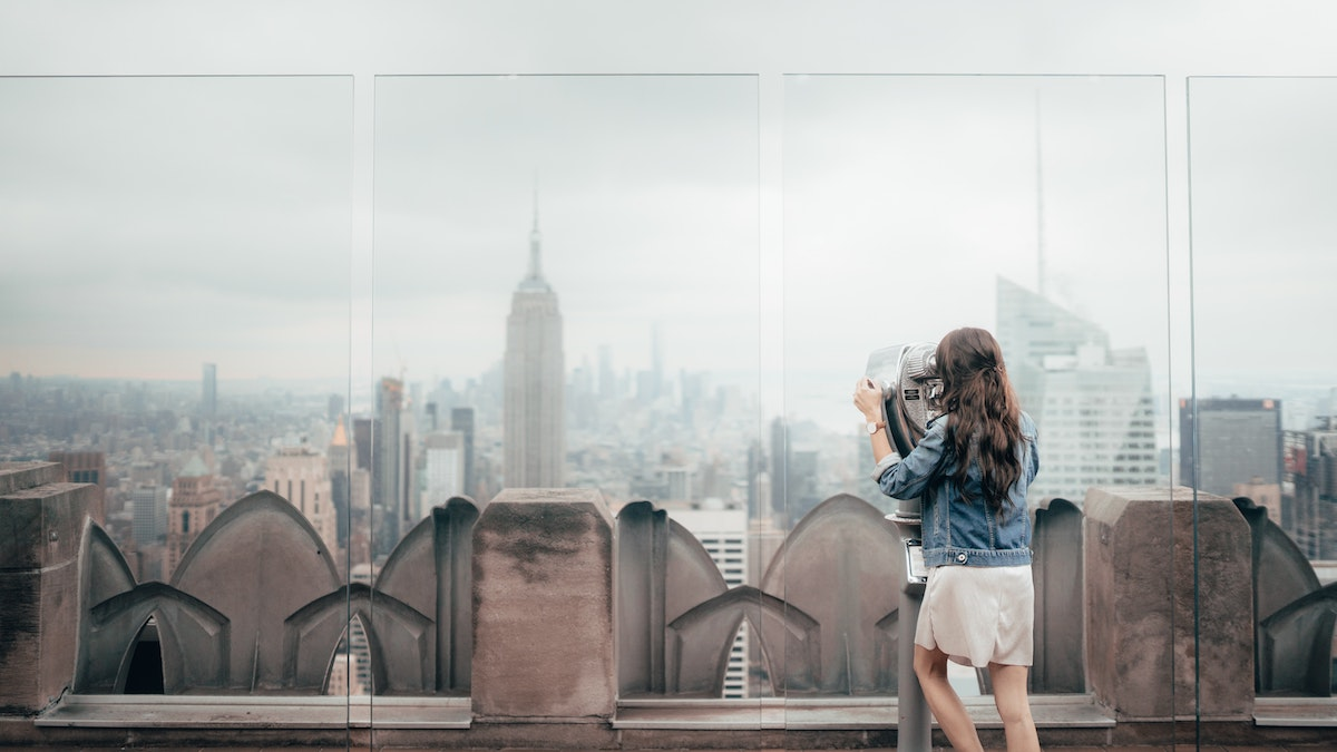 Women at the top of the rock enjoying a staycation in NYC